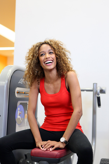 Lady smiling at the gym